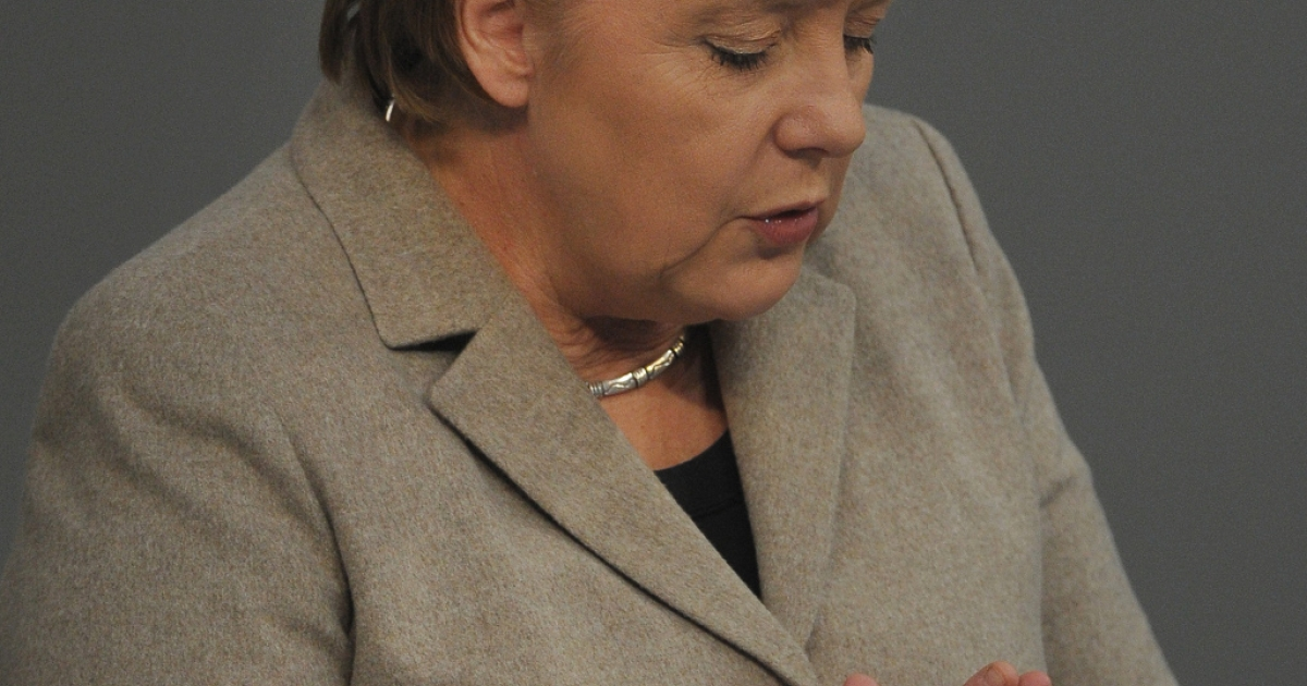 German Chancellor Angela Merkel strikes a prayerful pose in the Bundestag today - as well she might - given the news from Europe's stock markets.</p>