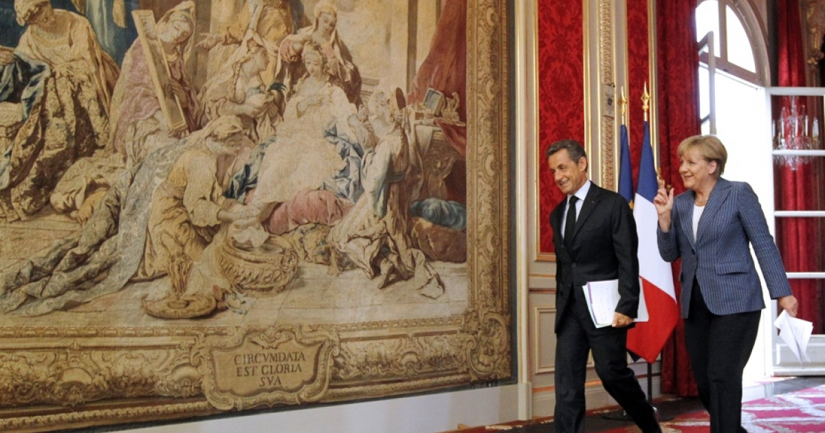 France's president Nicolas Sarkozy and German Chancellor Angela Merkel arrive for a joint press conference at the Elysee presidential palace in Paris on August 16, 2011 after a meeting between the two leaders on debt crisis.</p>