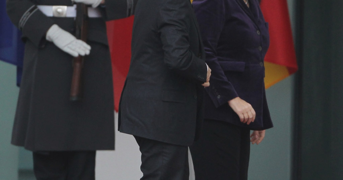 So happy to see each other after the holidays: French President Nicolas Sarkozy and German Chancellor Angela Merkel in Berlin today, heading in to their latest meeting on how to save the euro</p>