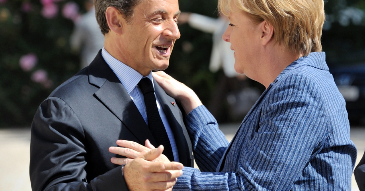 France's President Nicolas Sarkozy welcomes German Chancellor Angela Merkel as she arrives for a meeting on debt crisis on August 16, 2011 at the Elysee presidential palace in Paris. Markets have been watching anxiously to see whether they would agree a plan to boost confidence and tame an unprecedented sovereign debt crisis.</p>