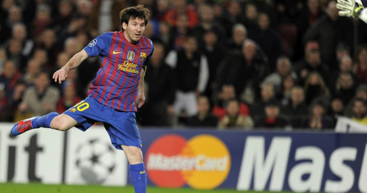 Lionel Messi chips in the first of his five goals last night.</p>
