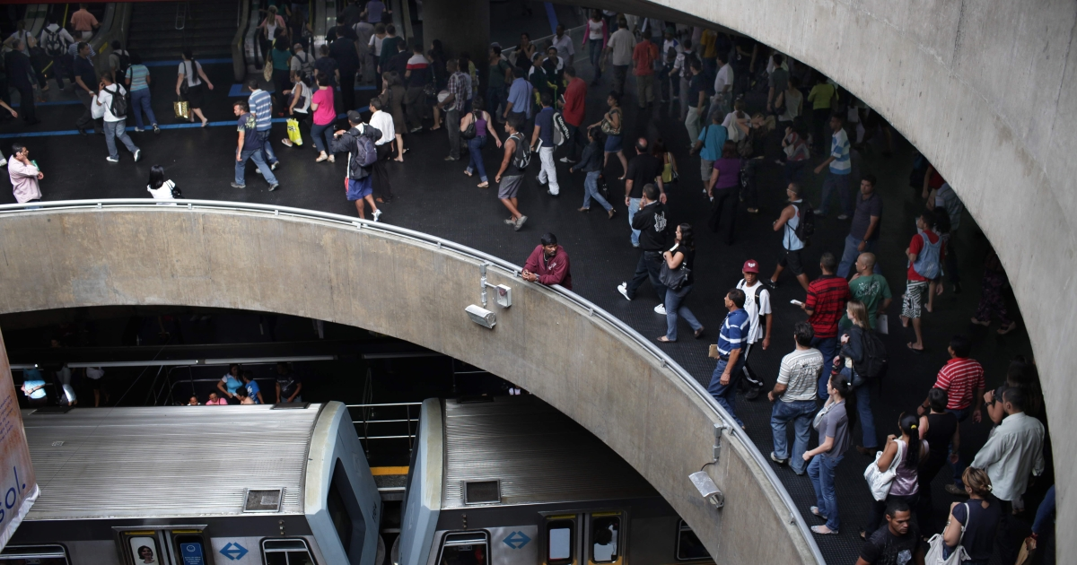 Passengers board a train in Sao Paulo, home of the world's most-crowded metro system.</p>