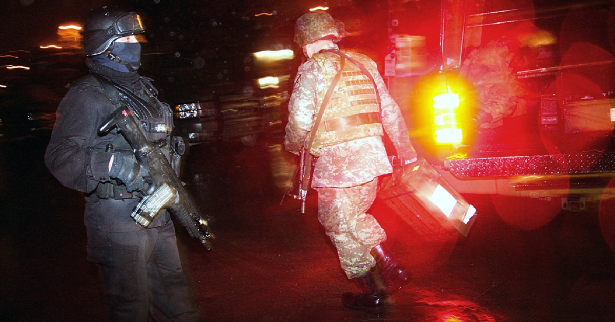 A state police officer and a Mexican soldier are seen during a confrontation with members of a gang. 13 suspected gang members were arrested in Temixco on Wednesday.</p>