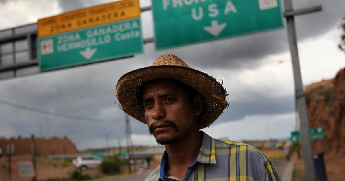Mexican immigrant Luis Manuel, 29, walks along the U.S.-Mexico border after being deported from Arizona to Nogales, Mexico on July 27, 2010 in Nogales, Mexico.</p>