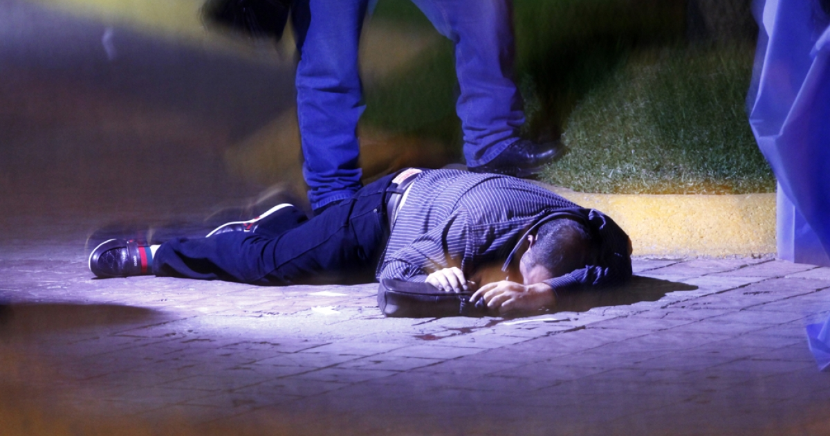 The dead person lies on the ground after a clash between gangs in Guadalajara, Mexico, Sept. 18, 2012.</p>