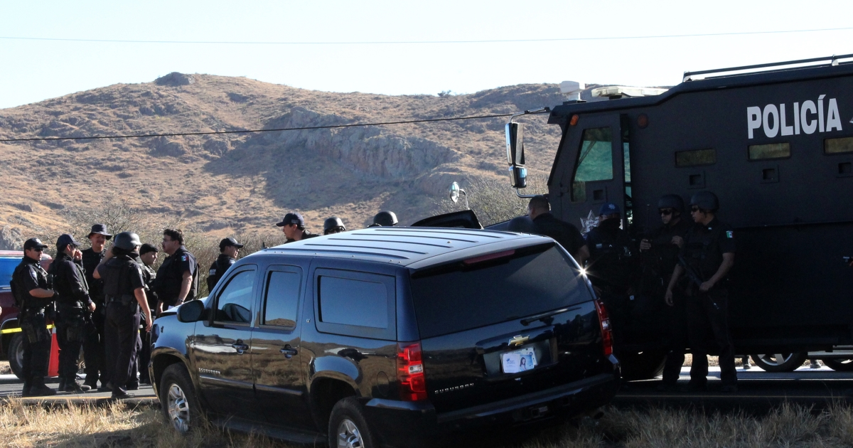 Mexican police guard a US Embassy vehicle after it came under attack by gunmen in Santa Maria del Rio, San Luis Potosi State, on Feb. 15, 2011. US Immigration and Customs Enforcement agent Jamie Zapata was shot and killed and a second agent, Victor Avila, was seriously wounded in the attack that is now the subject of a lawsuit.</p>