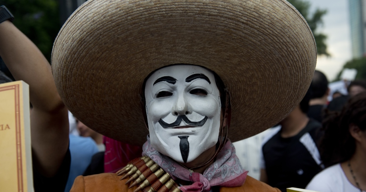 A Mexican University student dressed as a revolutionary and using an anonymous mask, takes part in a protest against Mexican presidential candidate for the Institutional Revolutionary Party (PRI), Enrique Peña Nieto, and media company Televisa, that does not hide its support for him, on May 23, in Mexico City. Thousands of university students marched along different main streets towards Zocalo square announcing a new student movement called