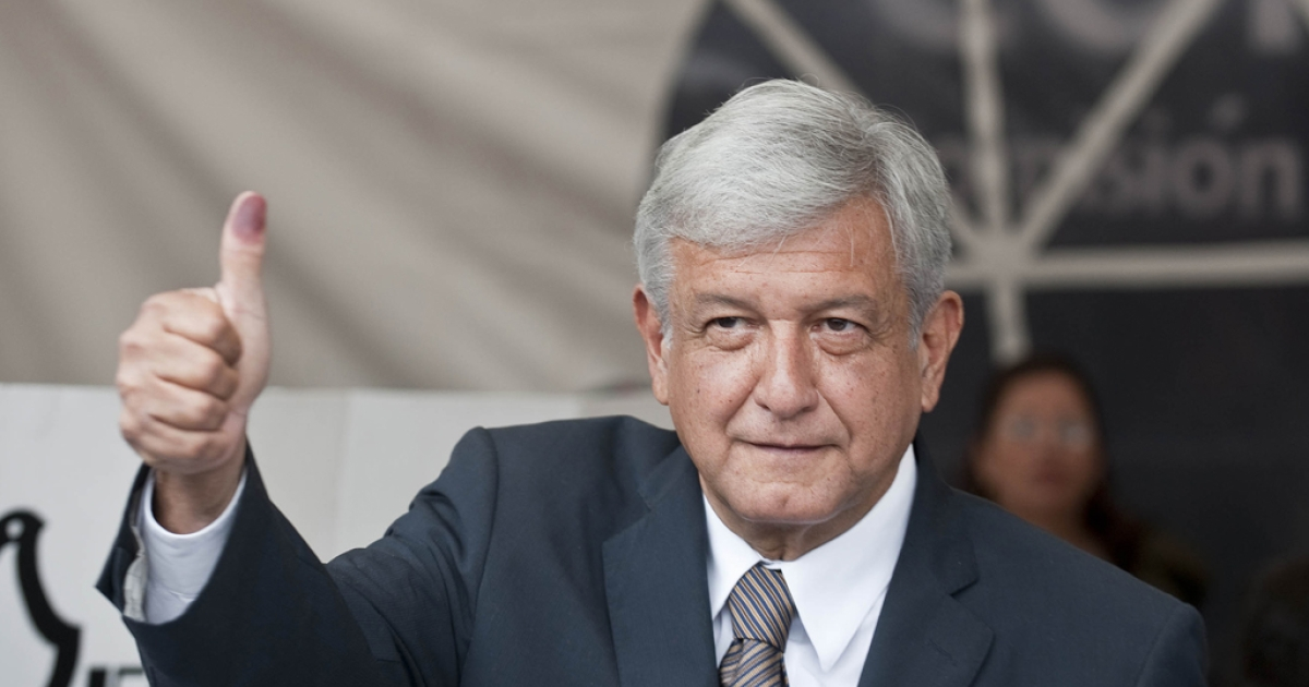 The Mexican presidential candidate for the leftist coalition Progressive Movement of Mexico, Andres Manuel Lopez Obrador, shows his ink-stained thumb after voting in the general elections on July 1, 2012 in Mexico City.</p>