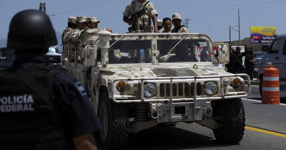 A Mexican army convoy patrols a stretch of highway in Los Cabos on the eve of the G20 summit on June 17, 2012.</p>