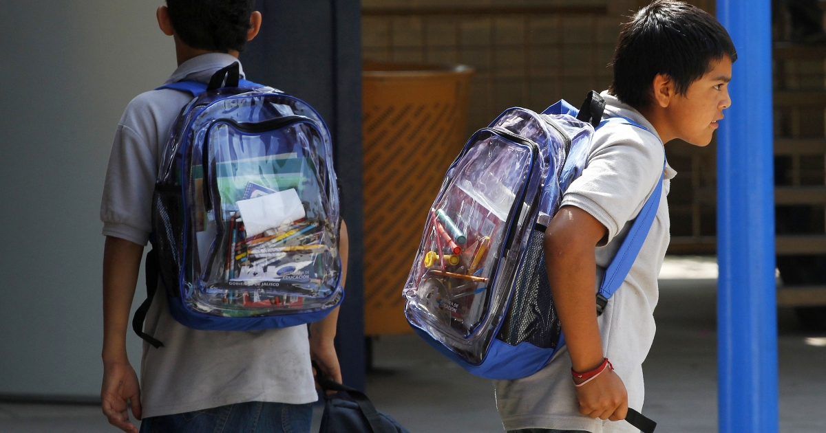 High school students carry see-through backpacks in Guadalajara, Mexico, part of a recently introduced