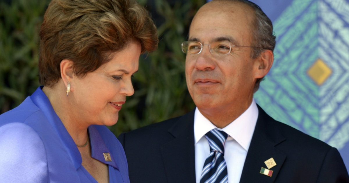 Mexican President Felipe Calderon, right, greets Brazilian President Dilma Rousseff prior to the opening of the G20 Leaders Summit in Los Cabos, Baja California, Mexico on June 18.</p>