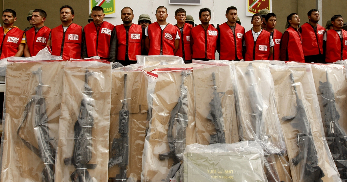 Fourteen alleged members of the Zetas drug cartel and seized weapons are presented to the press in Monterrey, Mexico. Daniel Elizondo, also known as