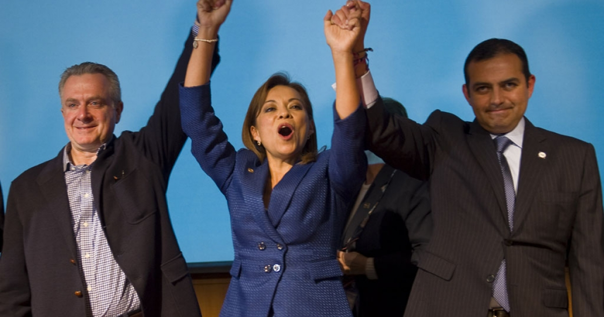 Mexican presidential candidate Josefina Vazquez Mota (C) celebrates her victory with her counterparts Santiago Creel (L) and Ernesto Cordero (R) from National Action Party (PAN in Spanish) during a press conference in Mexico City on February 5, 2012. Mota is the official presidential candidate of the National Action Party.</p>