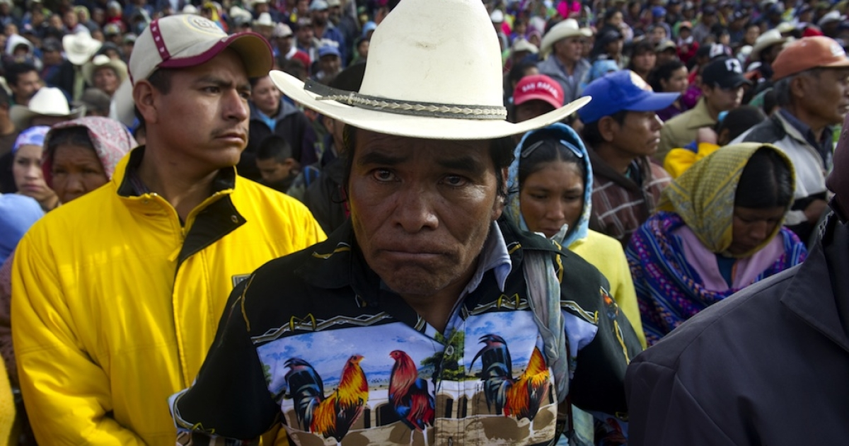 Raramuris indigenous people gather to receive humanitarian aid delivered by the Mexican Red Cross in Pitoreal town, Chihuahua state, Mexico on January 21, 2012.</p>