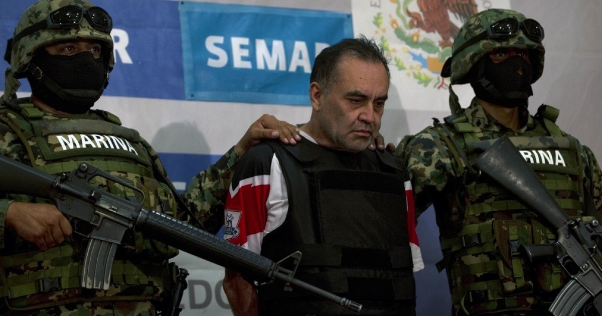 Mexican marines reel in an alleged cartel agent.</p>