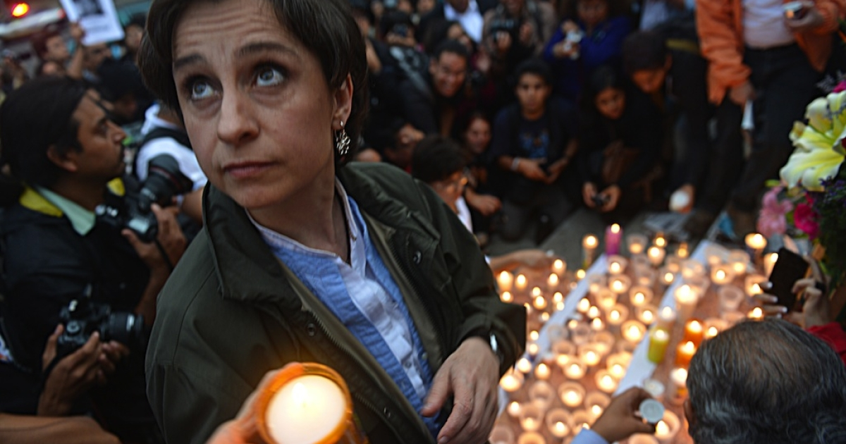 Mexican journalist Carmen Aristegui joins colleagues, relatives and friends of murdered journalists at Independence Angel monument in Mexico City on May 5, 2012 for a vigil to protest against violence towards the media.</p>