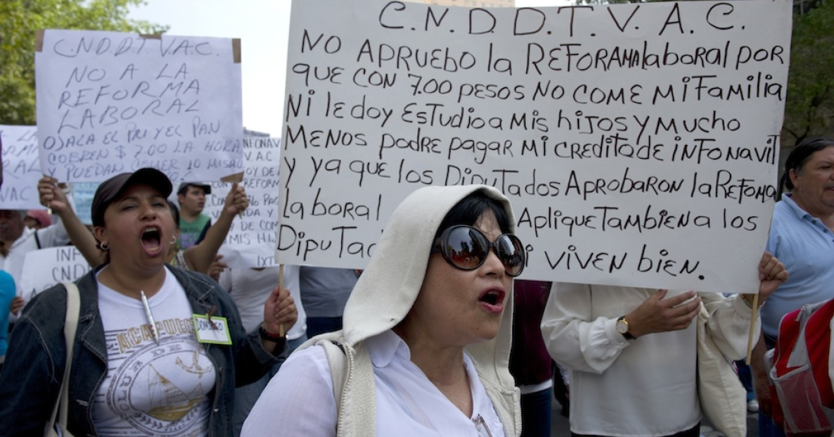 Women shout slogans during a protest against the labor reform bill in Mexico City on October 23, 2012. The bill passed the Congress this week and has been sent to President Calderon for his signature.</p>