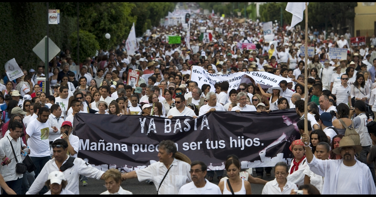 Thousand of people demonstrate against violence along the streets of Cuernavaca, Morelos state, 50 miles from Mexico City, on April 6, 2011. The demonstration was lead by poet and journalist Jaime Sicilia, whose son, Juan Francisco (24), was killed along with six friends on March 27. The authorities are still investigating the killing. The banner reads,