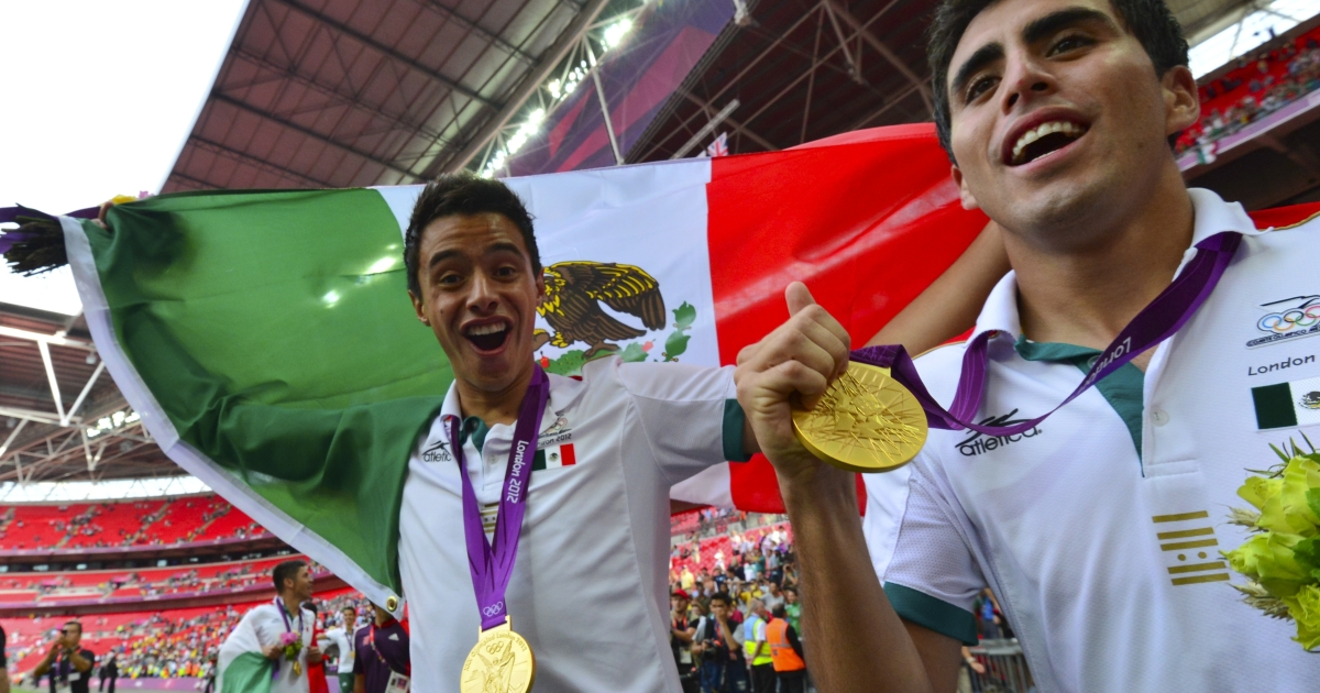 Mexico soccer players in ecstasy with their gold medals after their surprise victory over Brazil at the London Olympic Games on Aug. 11, 2012 at the Wembley stadium in London.</p>