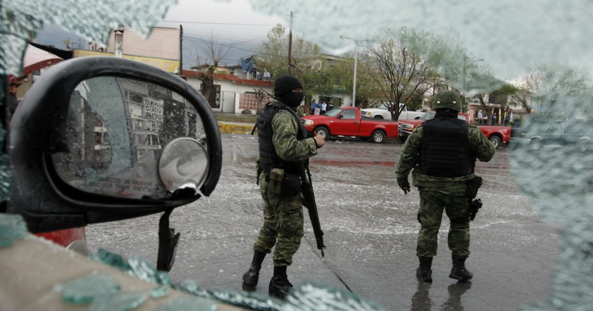 Two soldiers in Monterrey, the capital of Nuevo Leon state in northern Mexico, on February 8, 2012.</p>