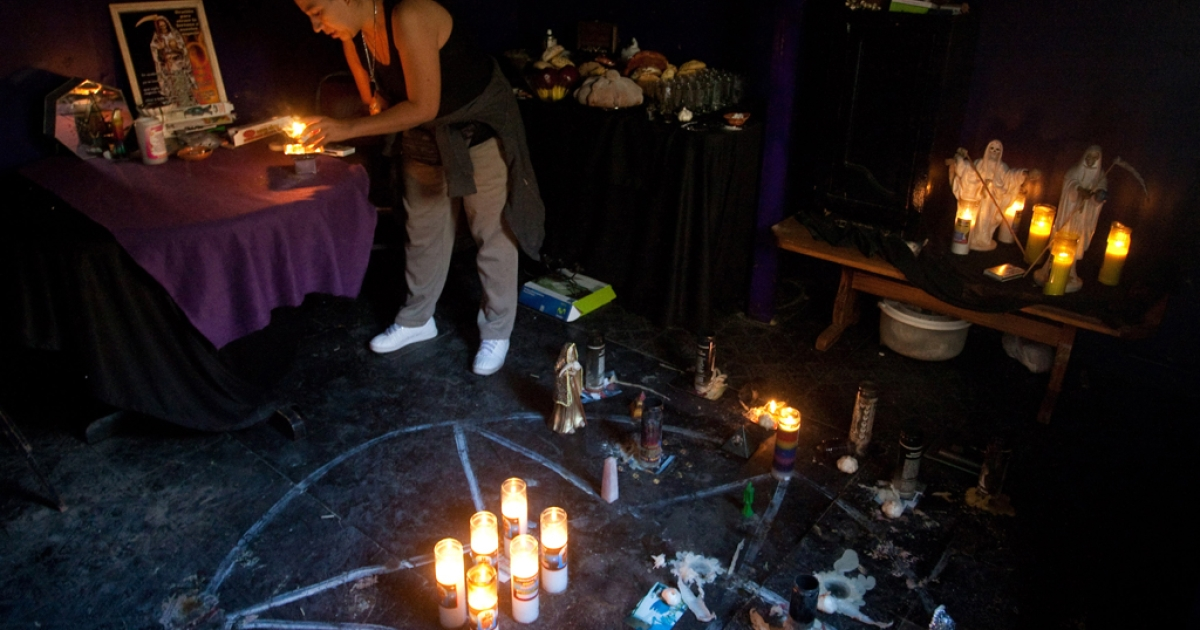 Yolanda Salazar during one of the rituals to the Santa Muerte (Saint of Death) in the sanctuary placed at her home in Ciudad Juarez, Chihuahua state, Mexico on October 31, 2010.</p>