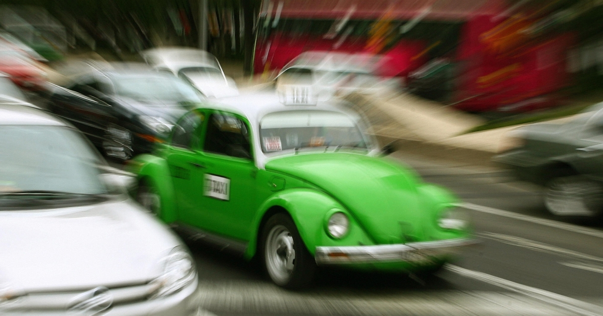A taxi driver takes his vintage beetle Volkswagen along the streets of Mexico City in 2007.</p>