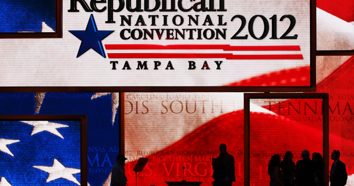 People stand on the main stage at the Tampa Bay Times Forum on the abbreviated first day of the Republican National Convention on August 27, 2012 in Tampa, Florida. The RNC is scheduled to convene today, but will hold its first full session tomorrow after being delayed due to Tropical Storm Isaac.</p>