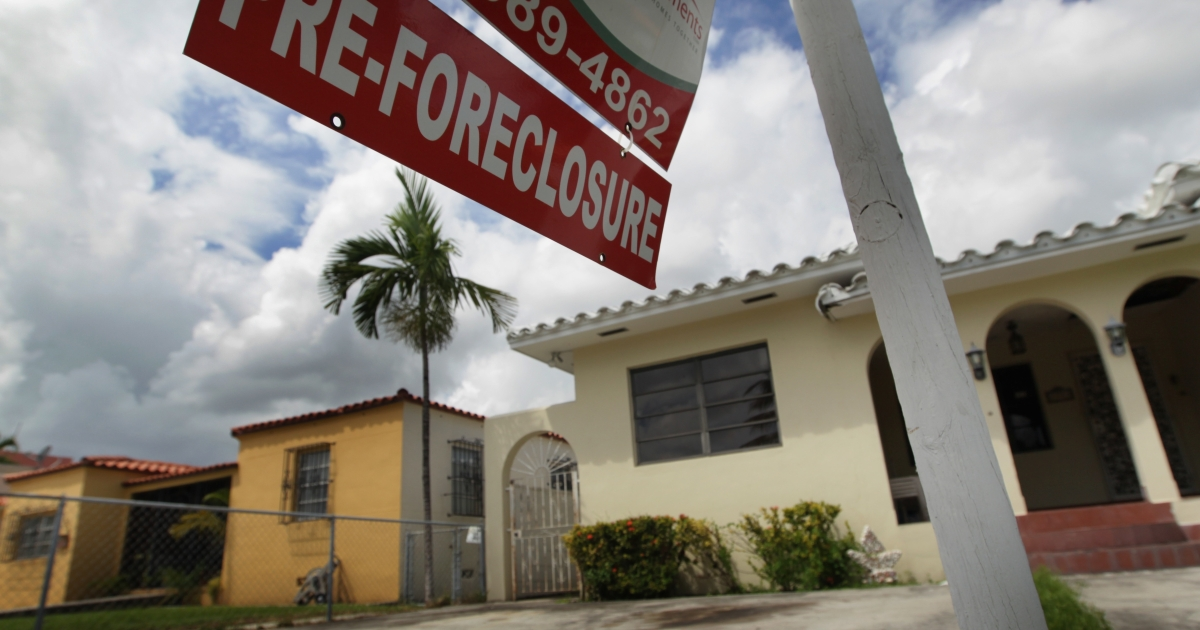A pre-foreclosure sign in front of a home in Miami on Sept. 16, 2010.</p>