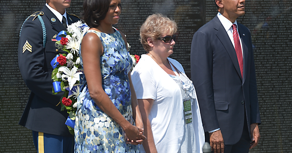 First Lady Michelle Obama stands with President Barack Obama and Rose Mary Brown, widow of Medal of Honor recipient Sgt. Leslie H. Sabo Jr., before placing a wreath at the Vietnam Veterans Memorial in Washington, DC, on Memorial Day, May 28, 2012.</p>