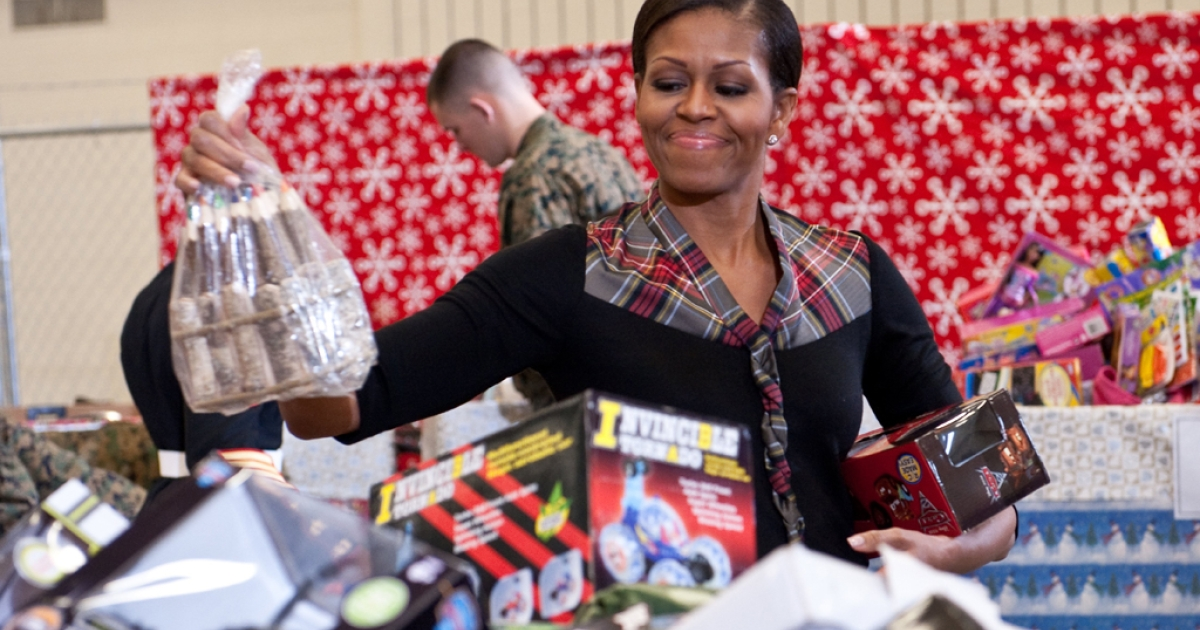 First Lady Michelle Obama was at the Toys for Tots campaign at Joint Base Anacostia-Bolling in Washington, where she was asked by Marine Lance Corporal Aaron Leeks to be his date for the Marine Corps Ball.</p>