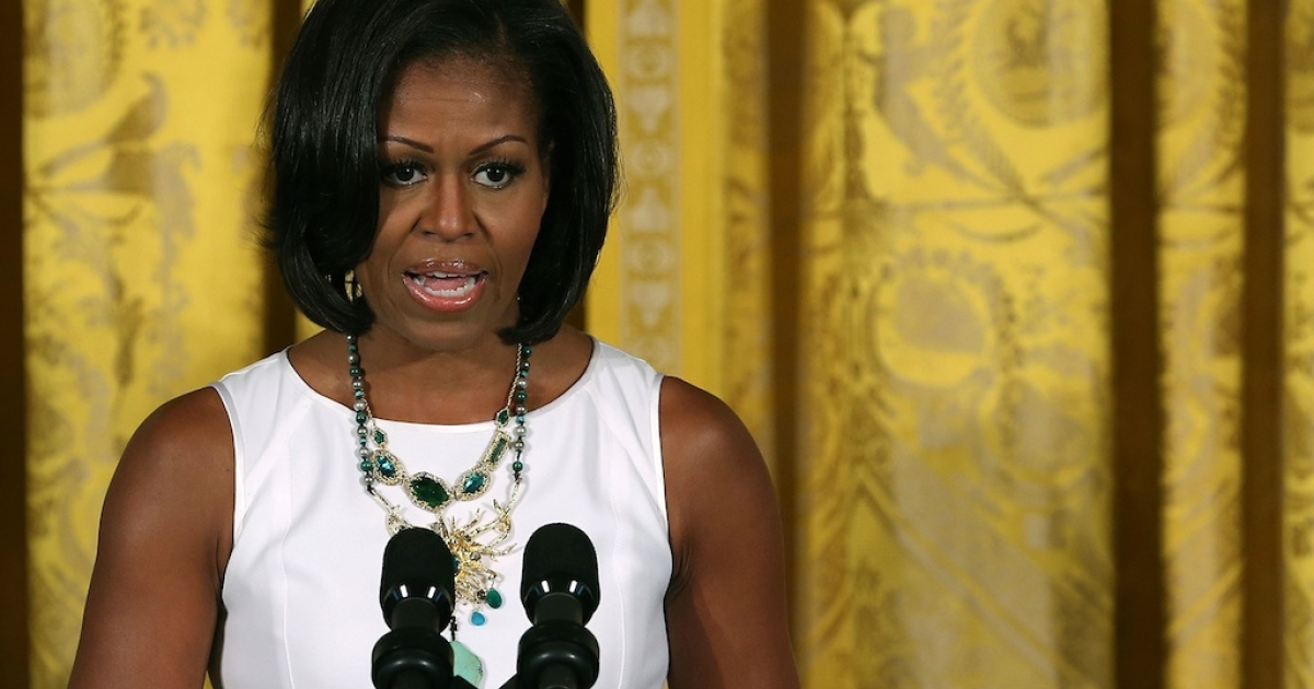 First lady Michelle Obama speaks during a luncheon in the East Room of the White House, on July 13, 2012 in Washington, DC. The First Lady on Feb 9 attended the funeral of 15-year-old Hadiya Pendleton, murdered in a gang-violence incident in Chicago in January.</p>