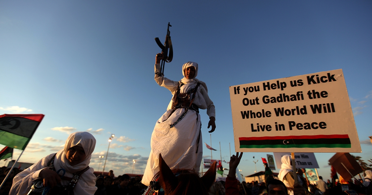 A Libyan rebel, member of the Warfala tribe parades on a horse in Benghazi on March 11, 2011 as thousands poured onto the streets of Benghazi on Friday, demanding Moamer Kadhafi quit and praying for victory in a bloody uprising inspired by revolutions in Egypt and Tunisia.</p>