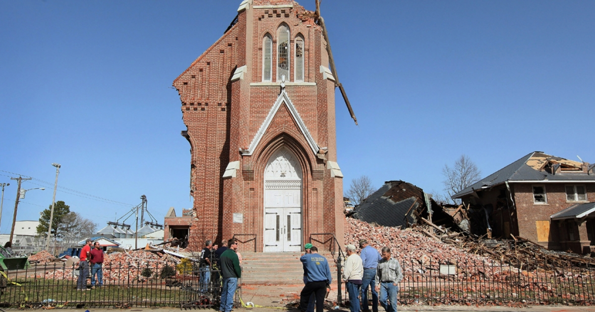 Residents look over the remains of  St. Joseph's Catholic Church on March 1, 2012 in Ridgeway, Ill. The 110-year-old church was completely destroyed after it was struck by a tornado early Tuesday. According to reports, at least 13 people died as severe weather swept through the middle of the country on Tuesday.  (Photo by Scott Olson/Getty Images)</p>