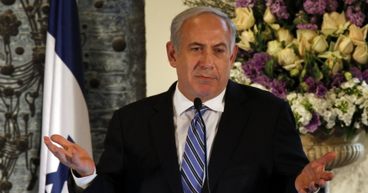 Israeli Prime Minister Benjamin Netanyahu gestures as he speaks during the swearing in ceremony of Israel's Supreme Court President, Judge Asher Grunis on Feb. 28, 2012 in Jerusalem.</p>