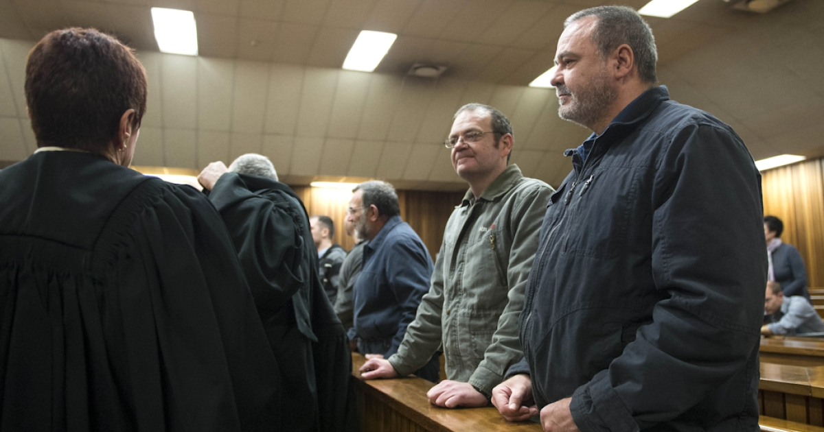 This photo taken on July 25, 2012, shows accused  Mike du Toit (R) and his brother Andre du Toit (L) standing in the courtroom at the Pretoria Hight Court. The 'Boeremag' trial (Afrikaans for Boer Force) of 20 rightwingers accused of high treason, terrorism and possession of weapons and explosives has been billed as one of the longest and most expensive in South Africa. On July 23, the Pretoria High Courg began delivering a judgement. On October 30, 2002, nine bomb blasts shook Soweto in the early hours of the morning, killing a woman and injuring her husband. The bombings were said to be aimed at creating instability and panic to allow the group to unseat the ruling African National Congress (ANC) and chase blacks and Indians from the country.</p>