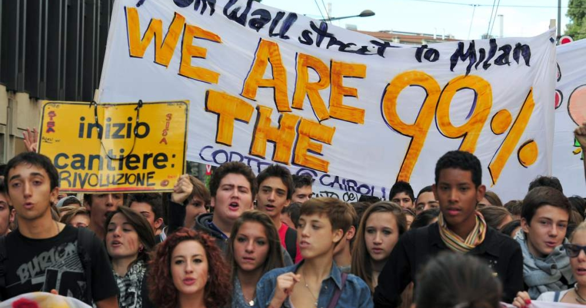 Students crowd a street during a demonstration on October 7, 2011 in Milan. Schools and universities across Italy closed as hundreds of thousands of students have taken to the streets to protest against the government's austerity package, that they say unfairly weighs against the education system.</p>