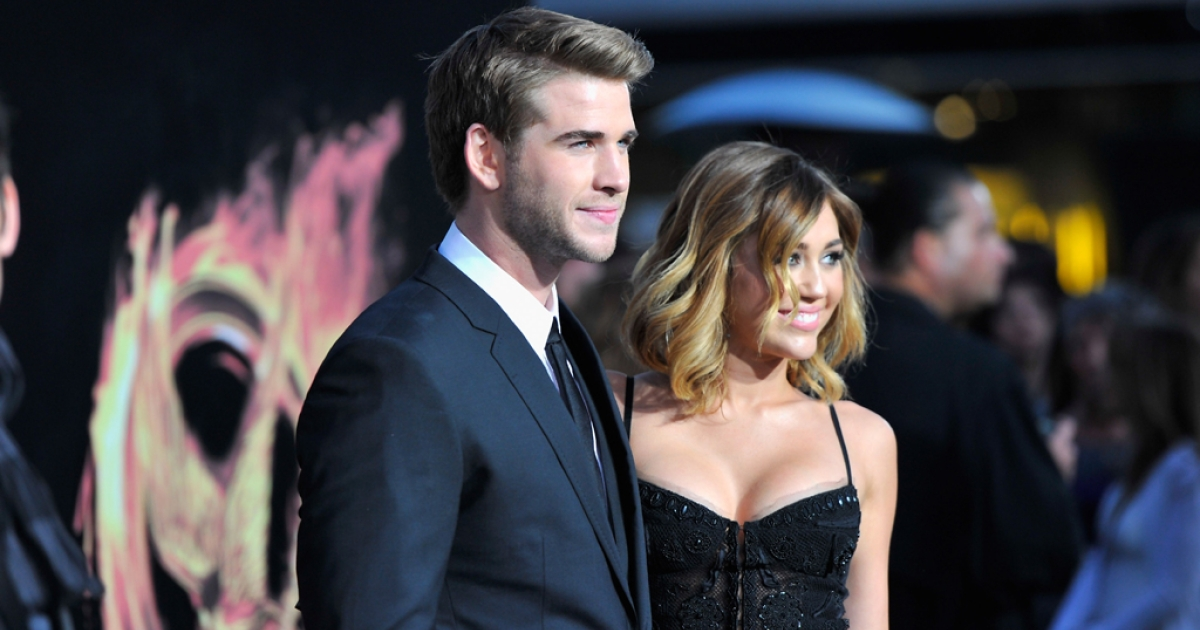 Actors Liam Hemsworth and Miley Cyrus arrive to the premiere of
