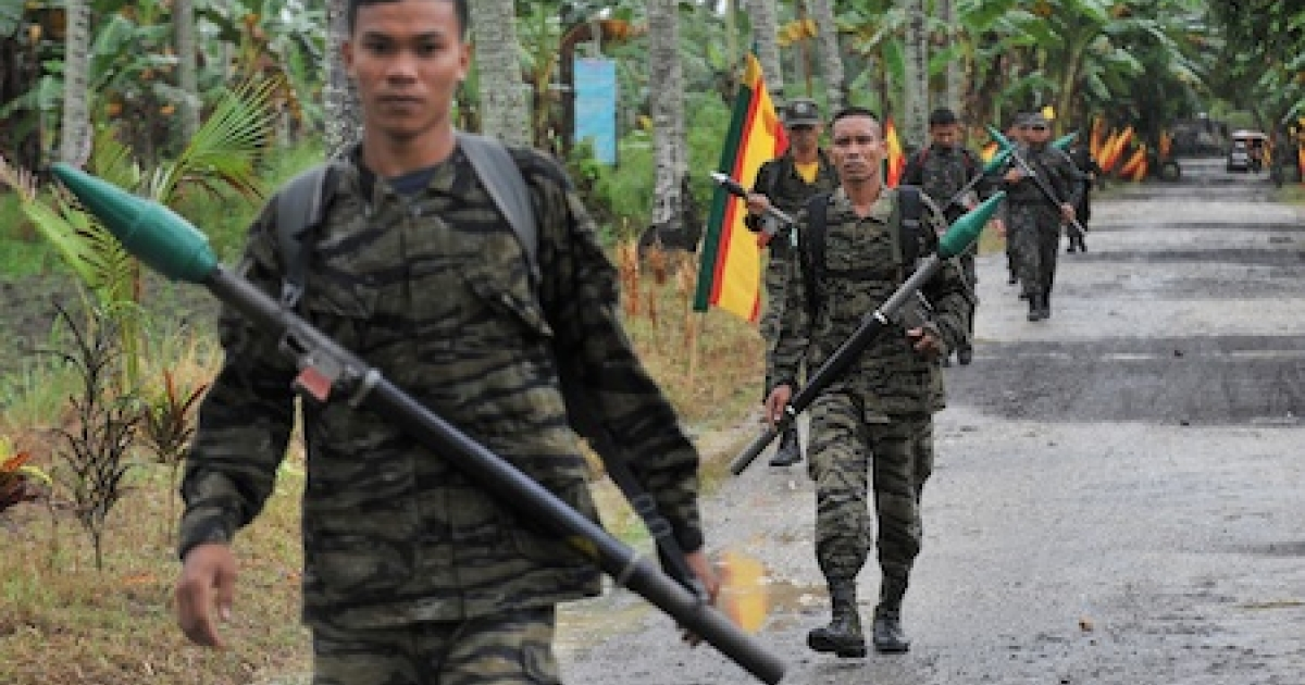 Moro Islamic Liberation Front (MILF) rebels in the Philippines patrol inside their base at Camp Darapan in the southern Philippines.</p>