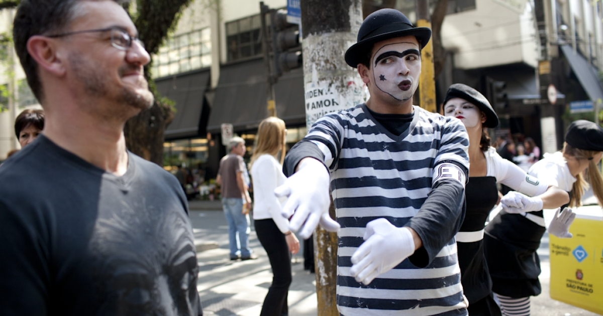 Mimes urge pedestrians to obey the trafic signals during a city campaign to reduce the casualties due to road accidents in Sao Paulo on September 27, 2011. Venezuela is also using mimes to try and stop traffic violations.</p>