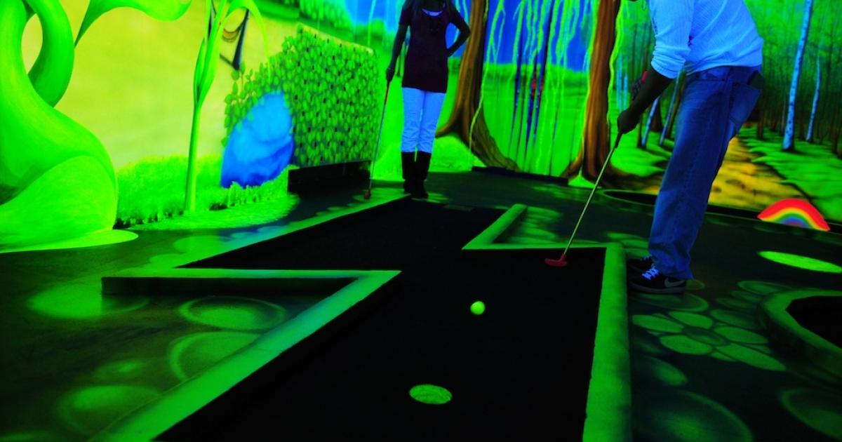 A couple play minigolf on September 17, 2010.</p>