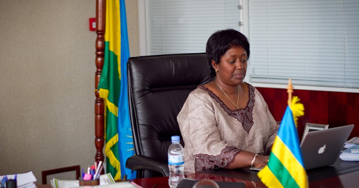 Rwanda's Health Minister, Agnes Binagwaho sits at her desk.</p>