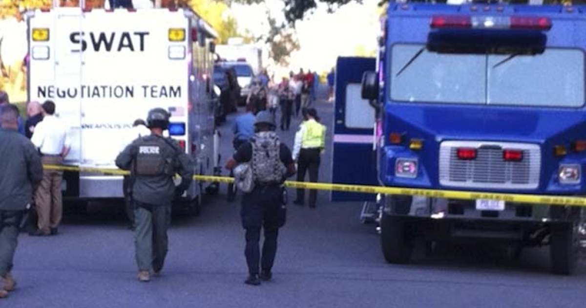 Police investigate a shooting at Accent Signage Systems on the north side of Minneapolis on September 27, 2012.</p>