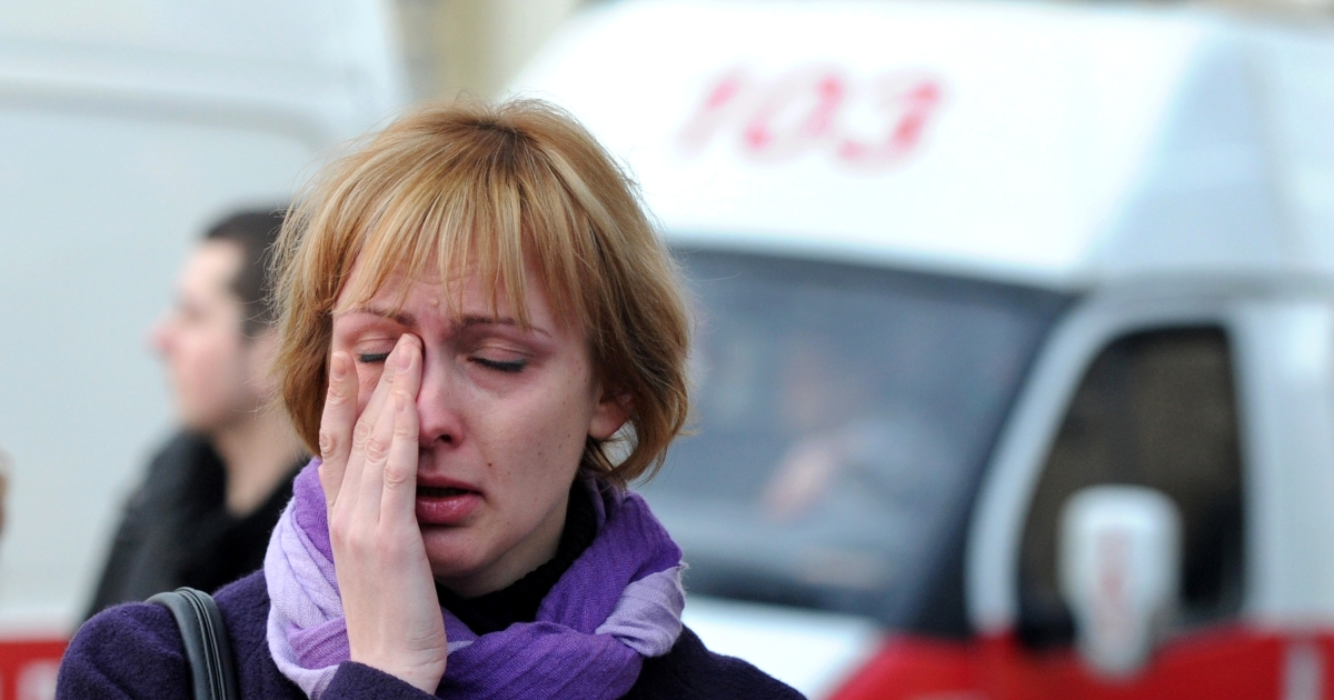 A woman cries near a metro station in downtown Minsk on April 11, 2011. At least seven people were killed in a blast at a metro station near Belarus President Alexander Lukashenko's office in Minsk, Belarussian television said.</p>
