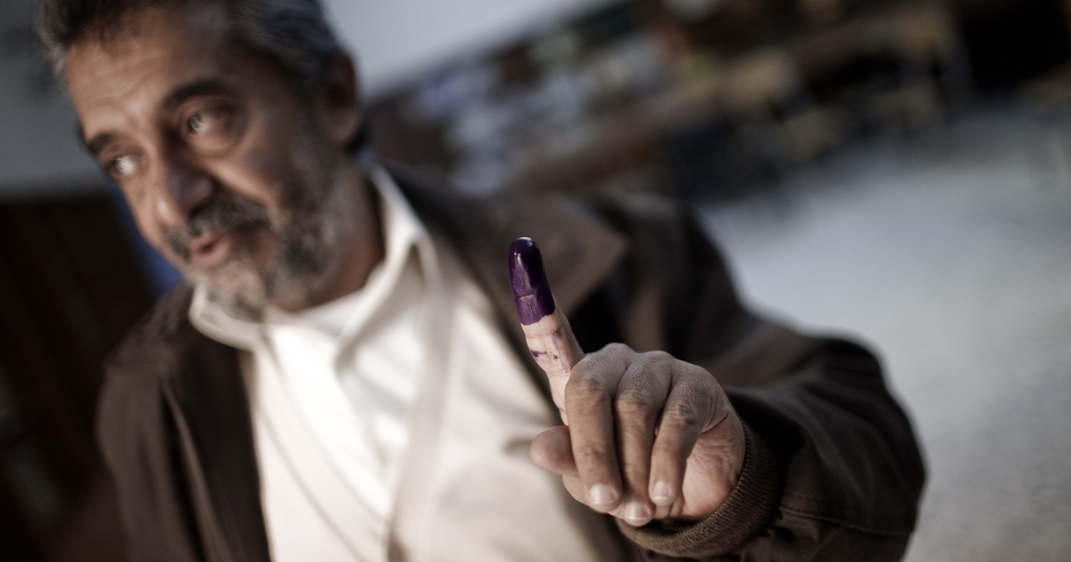 A resident of Misrata, Libya's-third largest city, shows his ink-stained finger after voting at a polling station in local council elections today, the first vote in post-Gaddafi Libya.</p>
