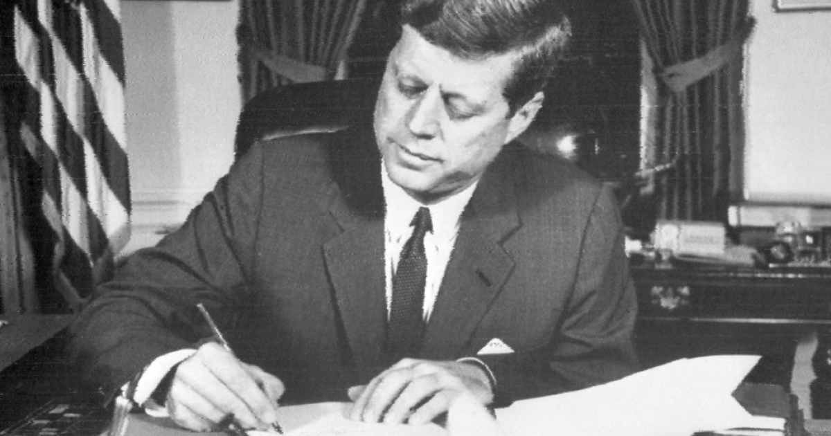 US President John Fitzgerald Kennedy signs the order of naval blockade of Cuba, on October 24, 1962 in White House, Washington DC, during the Cuban missiles crisis. On October 22, 1962, President Kennedy informed the American people of the presence of missile sites in Cuba. Tensions mounted, and the world wondered if there could be a peaceful resolution to the crisis, until November 20, 1962, when Russian bombers left Cuba, and Kennedy lifted the naval blockade.</p>