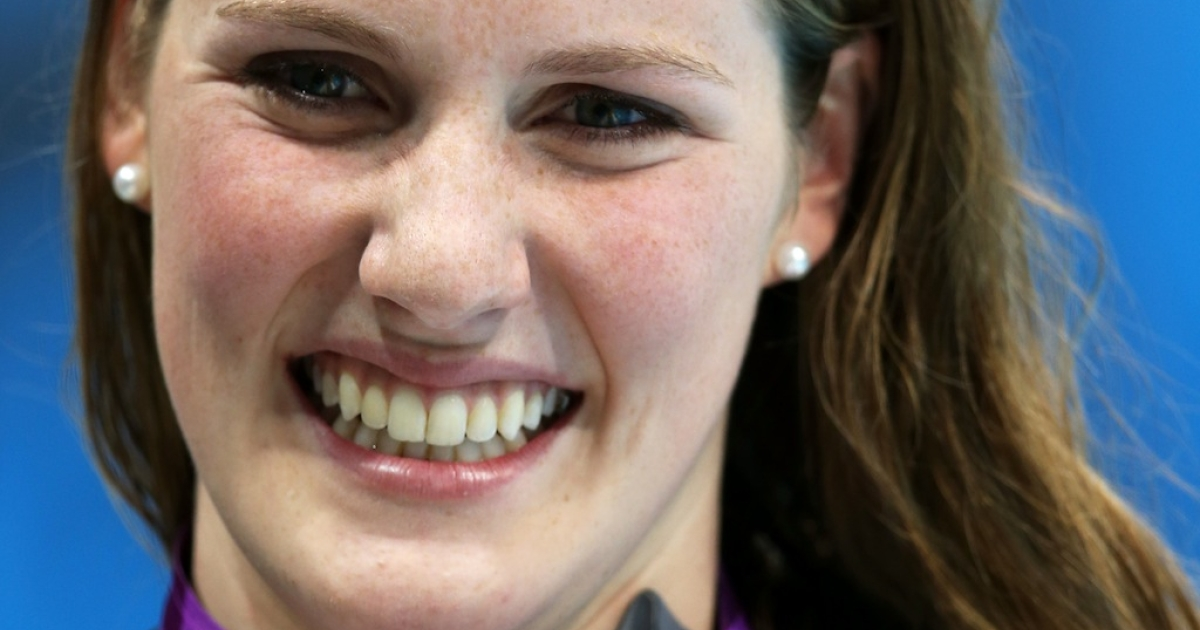 US teen Missy Franklin celebrates with her gold medal during the medal ceremony for the women's 100-meter backstroke at the 2012 Olympic Games at the Aquatics Centre on July 30, 2012 in London.</p>