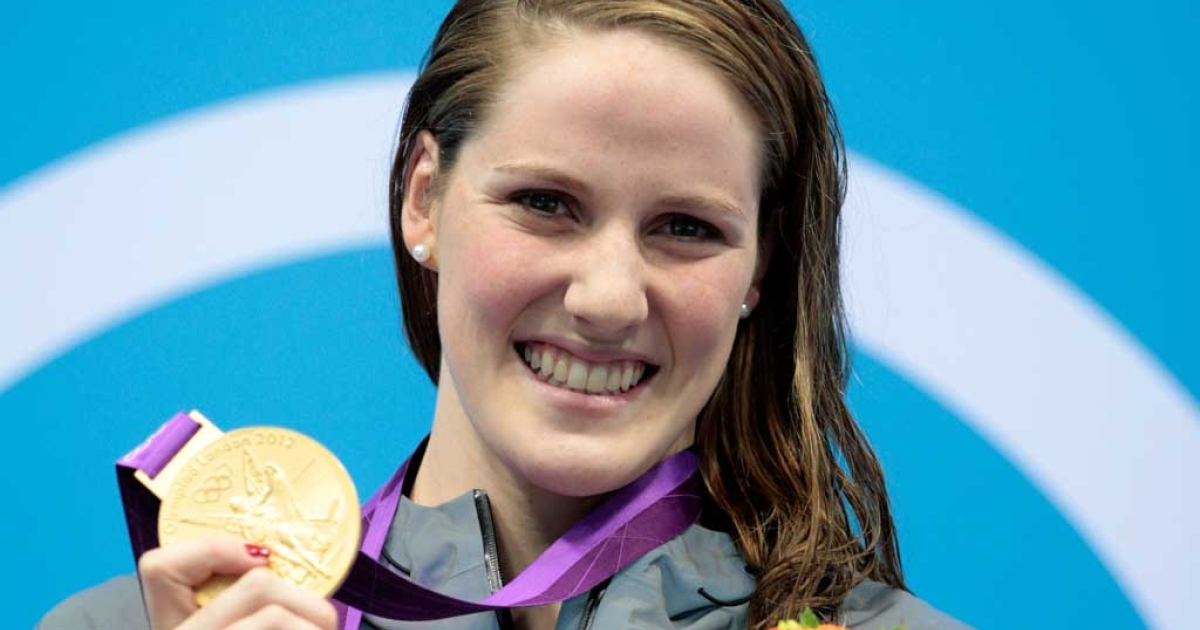 Missy Franklin of the United States celebrates with her gold medal during the medal ceremony for the Women's 100m Backstroke on Day 3 of the London 2012 Olympic Games at the Aquatics Centre on July 30, 2012 in London, England.</p>