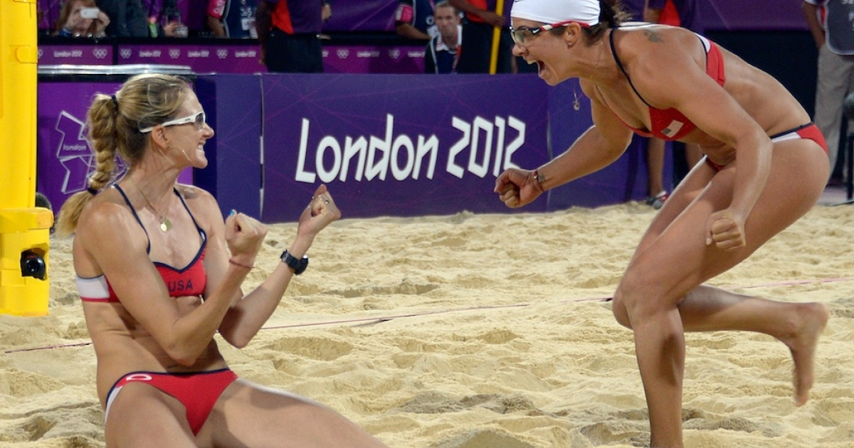 Misty May-Treanor and Kerri Walsh Jennings celebrate their victory in the Olympic beach volleyball final against fellow Americans April Ross and Jennifer Kessy on August 8, 2012.</p>