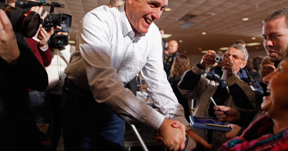 Republican presidential candidate Mitt Romney greets supporters and gives autographs during a rally at the Mississippi Valley Fairgrounds in Davenport, Iowa. Polls show that Romney is in a three-way tie with Ron Paul and Rick Santorum to win the Iowa caucus.</p>