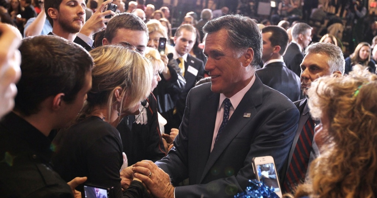 Republican presidential candidate and former Massachussetts Gov. Mitt Romney greets supporters during a primary night gathering at the Suburban Collections Showplace on February 28, 2012 in Novi, Michigan. Romney celebrated primary victories in Arizona and Michigan.</p>